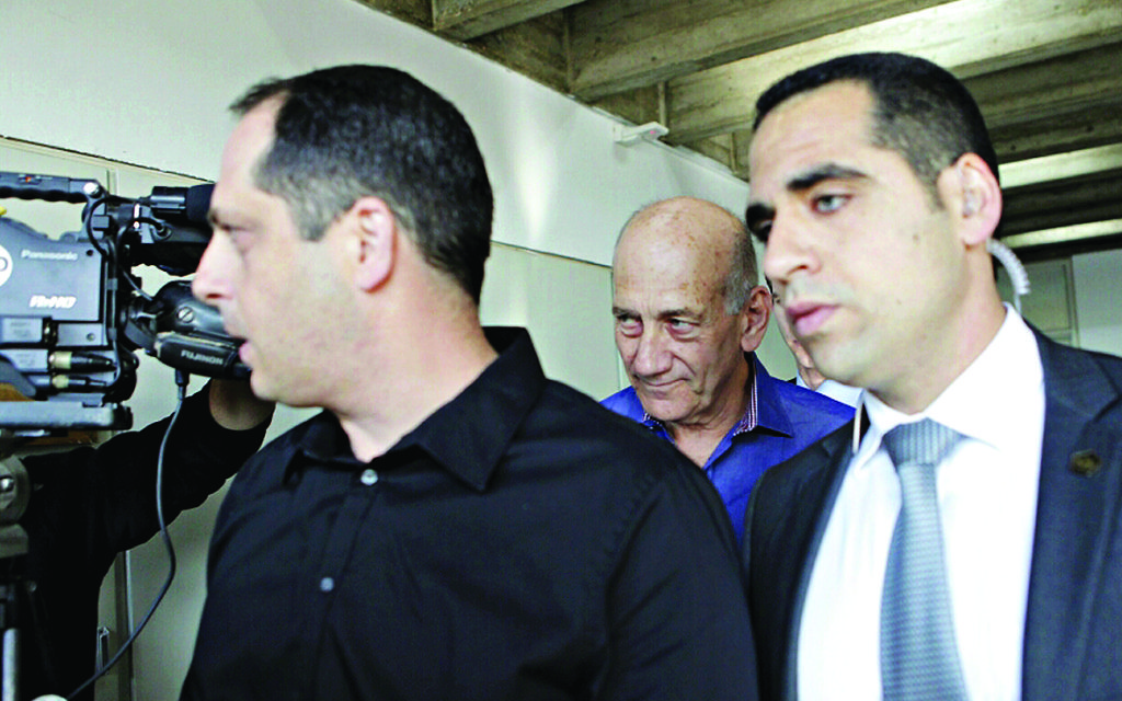 Olmert arrives to learn his fate.