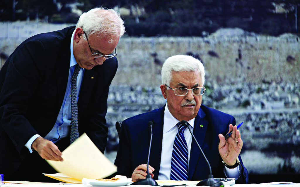 Palestinian Authority President Mahmoud Abbas  (right) with negotiator  Saeb Erekat (left)