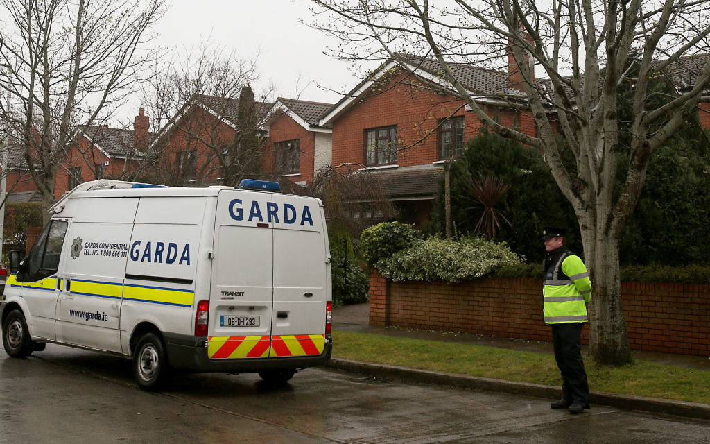 Members of An Garda outside the home of Ireland's Justice Minister Alan Shatter in Dublin.