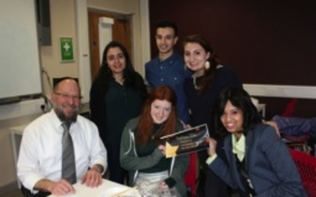 Students show off their UJS Student Awards certificate as they pose for a picture with Rabbi 'Rav Gav' Broder