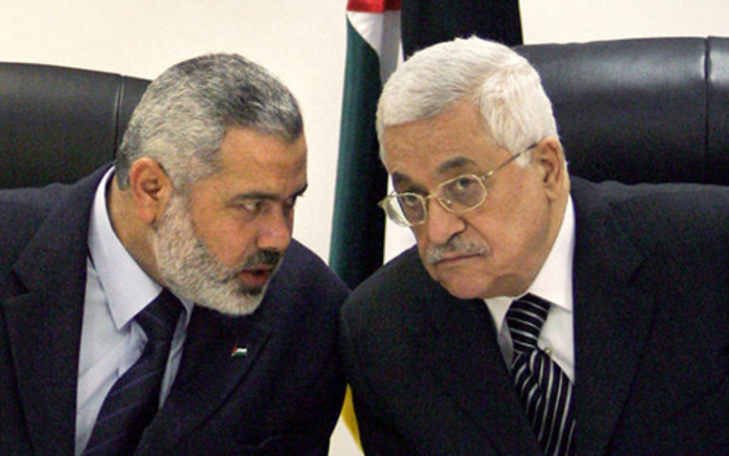 Palestinian Authority President Mahmoud Abbas, right, and Ismail Haniyeh of Hamas, left.