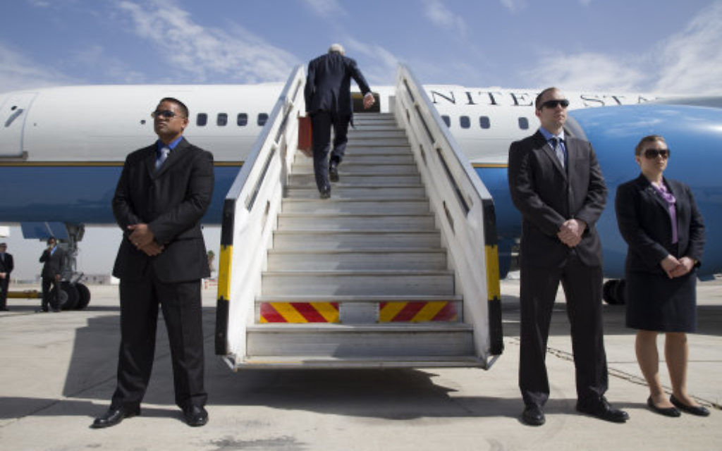 U.S. Secretary of State John Kerry climbs up the stairs of the plane to leave Tel Aviv, Israel Tuesday April 1, 2014, continuing on to NATO meetings in Brussels after meeting in Israel with Israeli Prime Minister Benjamin Netanyahu about the Middle East peace process talks. (AP Photo/Jacquelyn Martin, Pool)