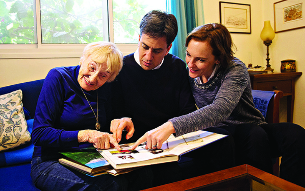 Miliband and his wife Justine were shown a photo album by his 84 year-old Aunt Sarah Ben Zvi at her home on Nachshonim Kibbutz. Photo: Stefan Rousseau/PA Wire