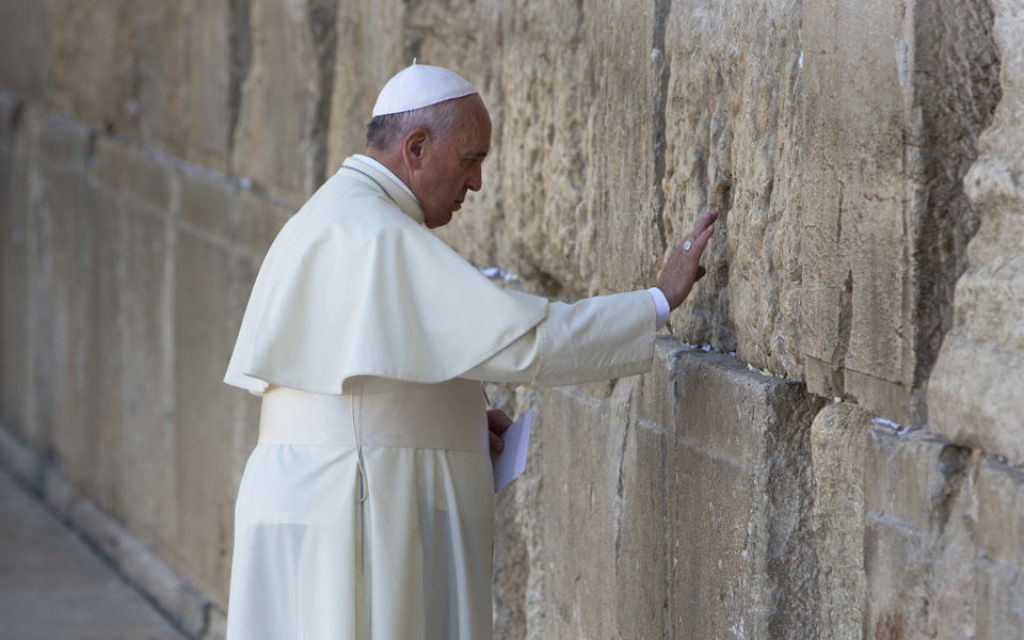 The Pope spent a few minutes at the Kotel and left a note inside an envelope in one of the cracks between the stones.