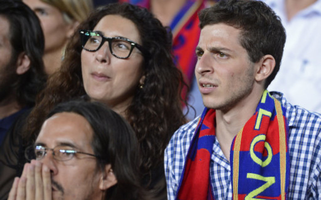 Gilad Shalit, right, is pictured during a Spanish La Liga soccer match between FC Barcelona and Real Madrid at the Camp Nou stadium in Barcelona. (AP)