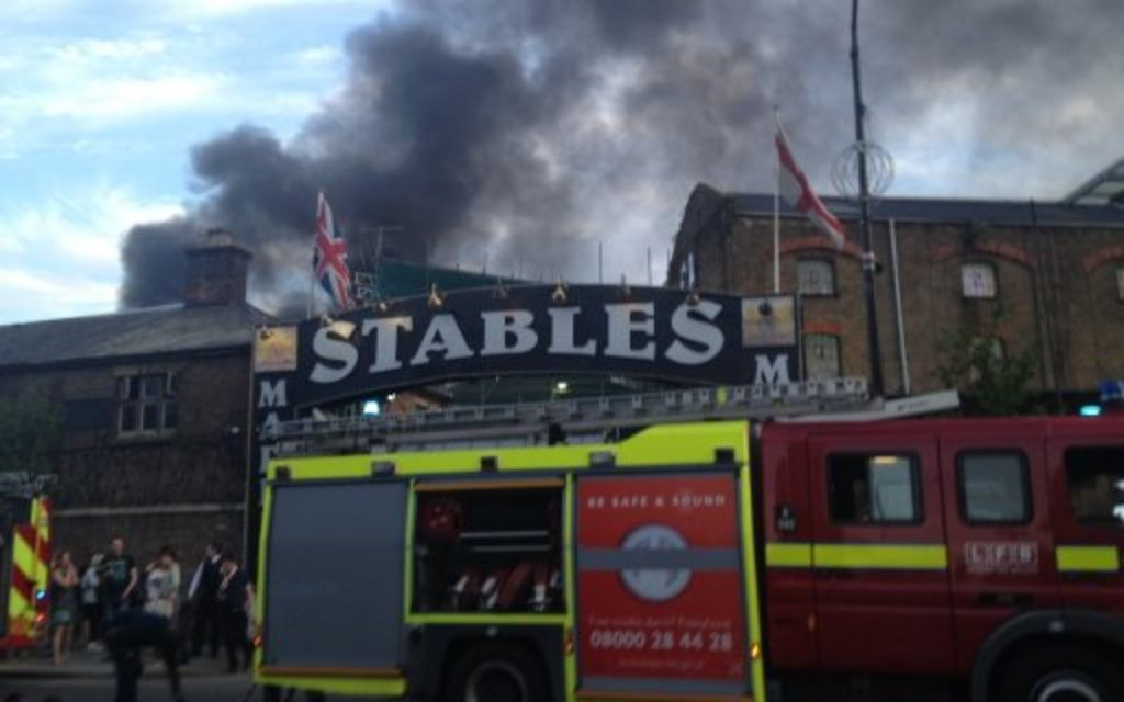 Smoke rises from the Stables Market area of Camden Town.