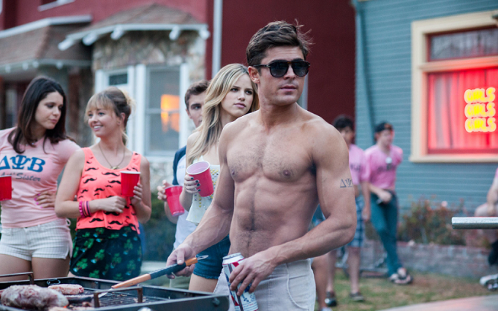 Zac Efron turning heads in a scene from his new film, Bad Neighbours