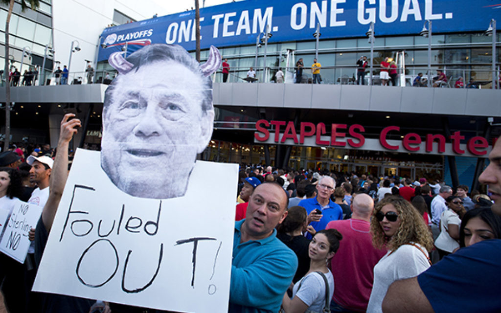 Basketball fans protest against racist comments made by LA Clippers owner Donald Sterling in Los Angeles. Photo: Lionel Hahn