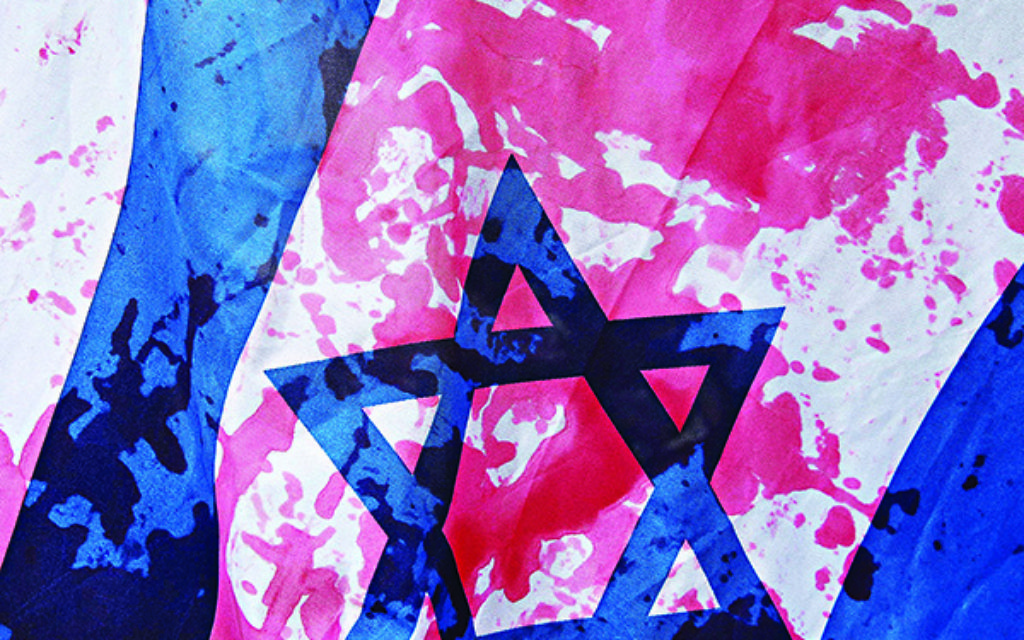 A blood-stained Israeli flag at a pro-Palestinian protest.