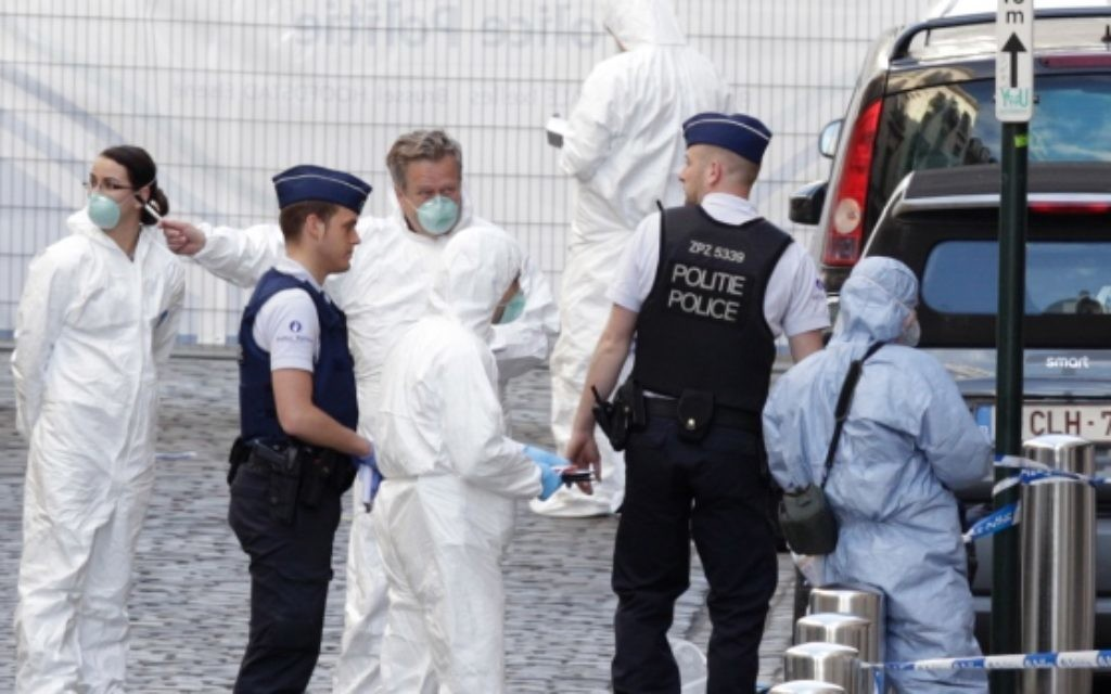 Forensics experts at the scene of the crime in Brussels