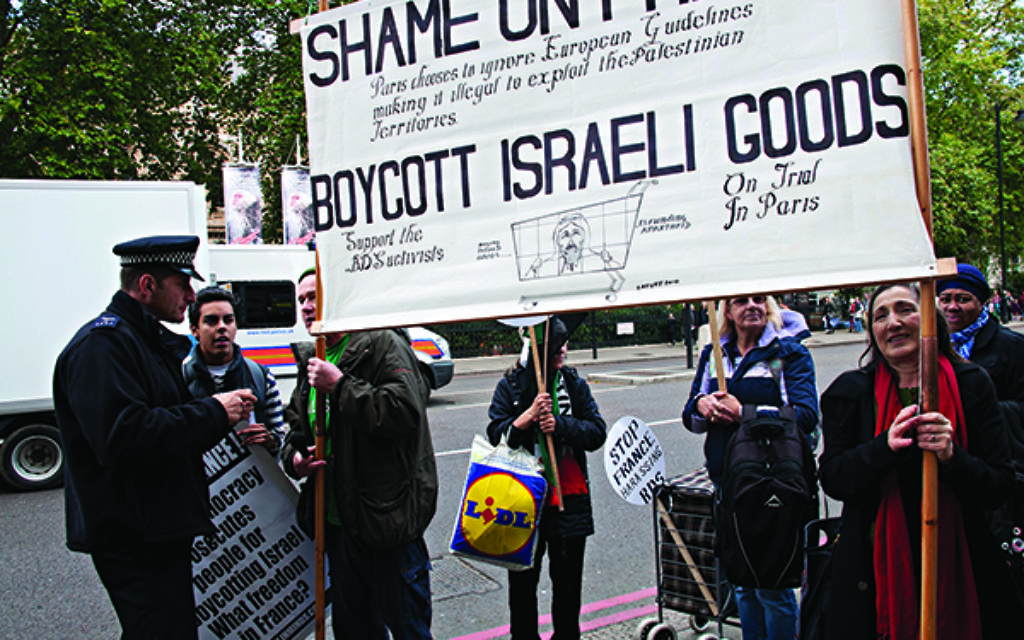 Pro-Palestinian protesters call for a boycott on Israeli goods in central London.