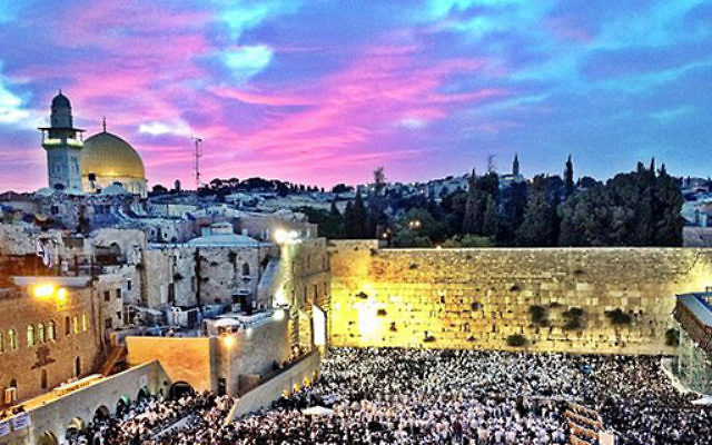 The Western Wall in Jerusalem, filled with Jewish pilgrims
