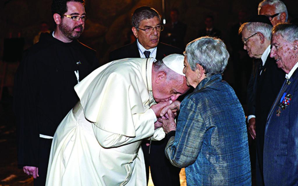 Pope Francis kisses a Shoah survivor's hand at Yad Vashem.