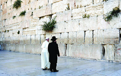 The Pope prays at the Western Wall