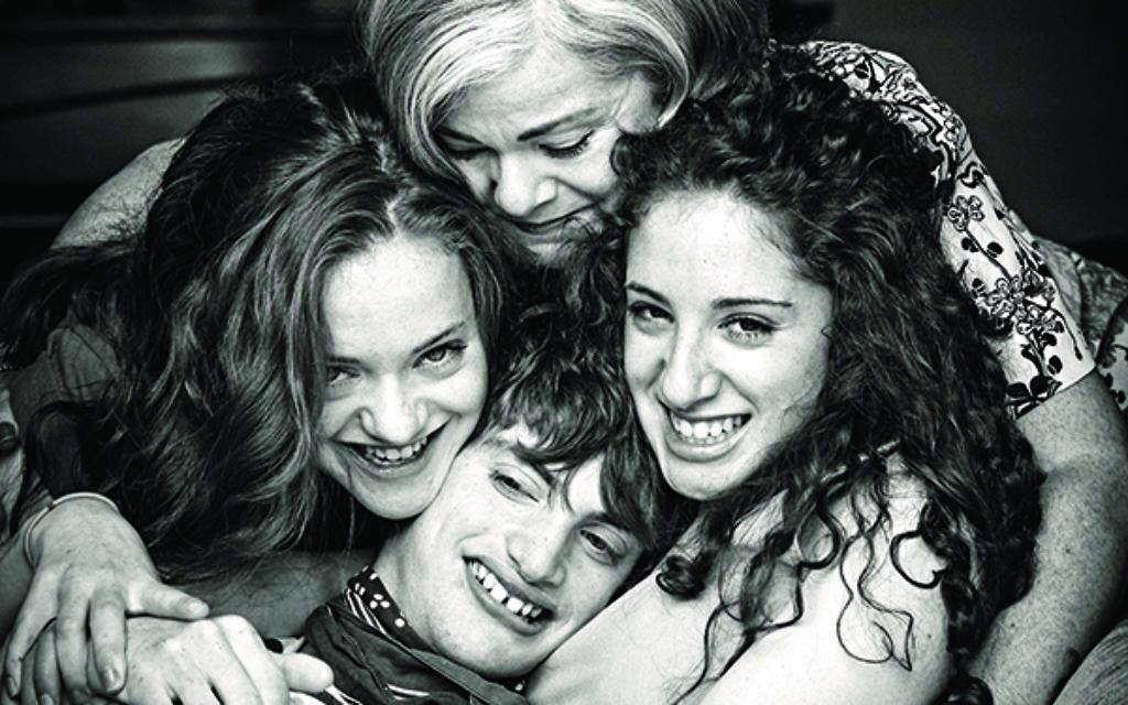 Ben Dawson enjoys a group hug with his family