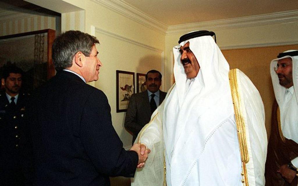Former Emir of Qatar Hamad bin Khalifa Al-Thani meets former US Deputy Secretary of Defense Paul Wolfowitz. In 2013 Hamad handed power over to his son, Tamim.