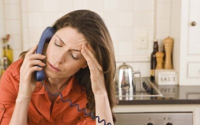 Paperweight has released an annual report on demand for services. Pictured is an image of a woman on the phone.