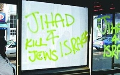 Graffiti on a bus stop in north London.