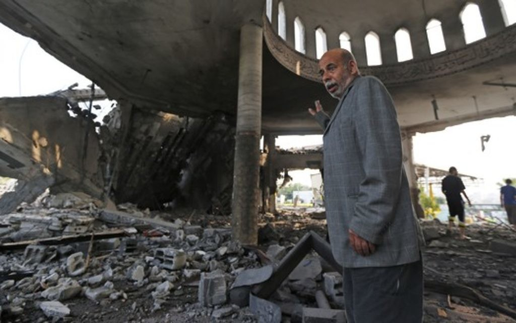Palestinian Khaled Sharmi, 67, inspects the damage in the Al Aqsa Martyrs mosque destroyed by an overnight Israeli strike, in Gaza City.