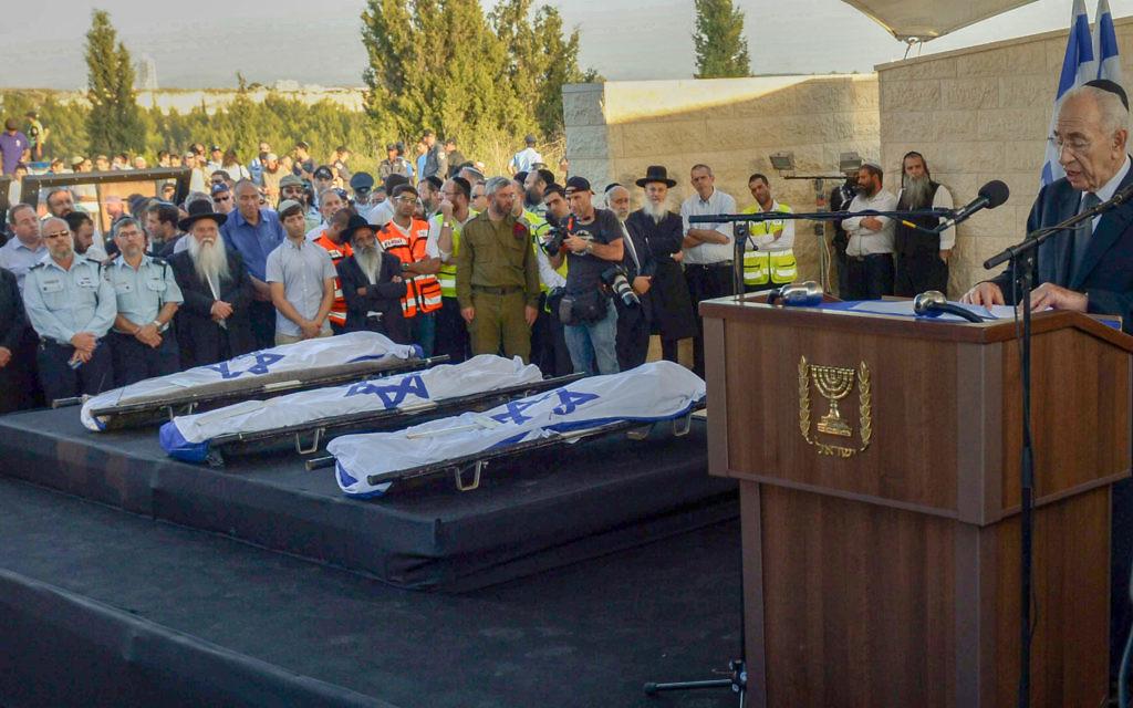 "Photo by Haim Zach/GPO/Israel Sun 01-07-2014 PLEASE CREDIT Haim Zach/GPO ONLY  Gil-Ad Shaer, Naftali Frenkel and Eyal Yifrach were to be laid to rest side by side in Modi'in cemetery on Tuesday evening, a day after the bodies of the three teens were found in the West Bank and 19 days after they vanished while hitchihiking near Hebron. President Shimon Peres spoke at the funeral saying, ""To all those who wish to vanquish us, I want to say that terror is a boomerang. It's targeted against us but hits its instigators. We bow our heads but won't lose our soul. I know that security forces will catch the murderers and they will be brought to justice.""  Prime Minister Benjamin Netanyahu mourned the loss of the three Israeli teens saying, ""We were charmed by the magic of their smile, their kindness, their joy of youth. Today became a day of national mourning.""  ðùéà äîãéðä ùîòåï ôøñ áäìååéú ùìåùú äçèåôéí ááéú äòìîéï áîåãéòéï öéìåí çééí öç / ìò""î"