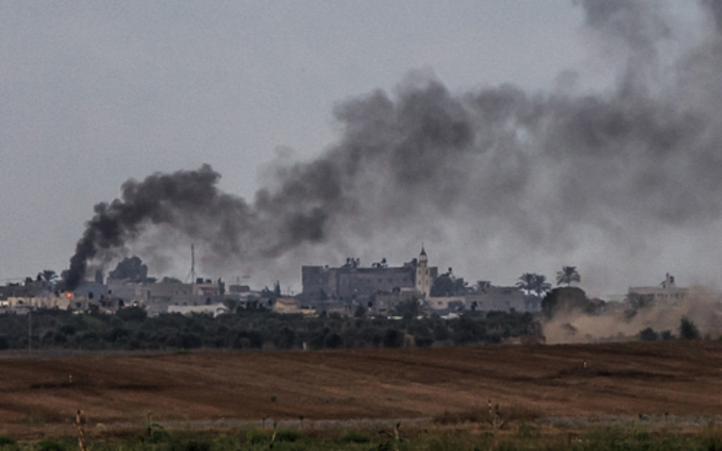 Smoke rises after an Israeli strike over the southern Gaza Strip. Photo: Jinipix/Israel Sun