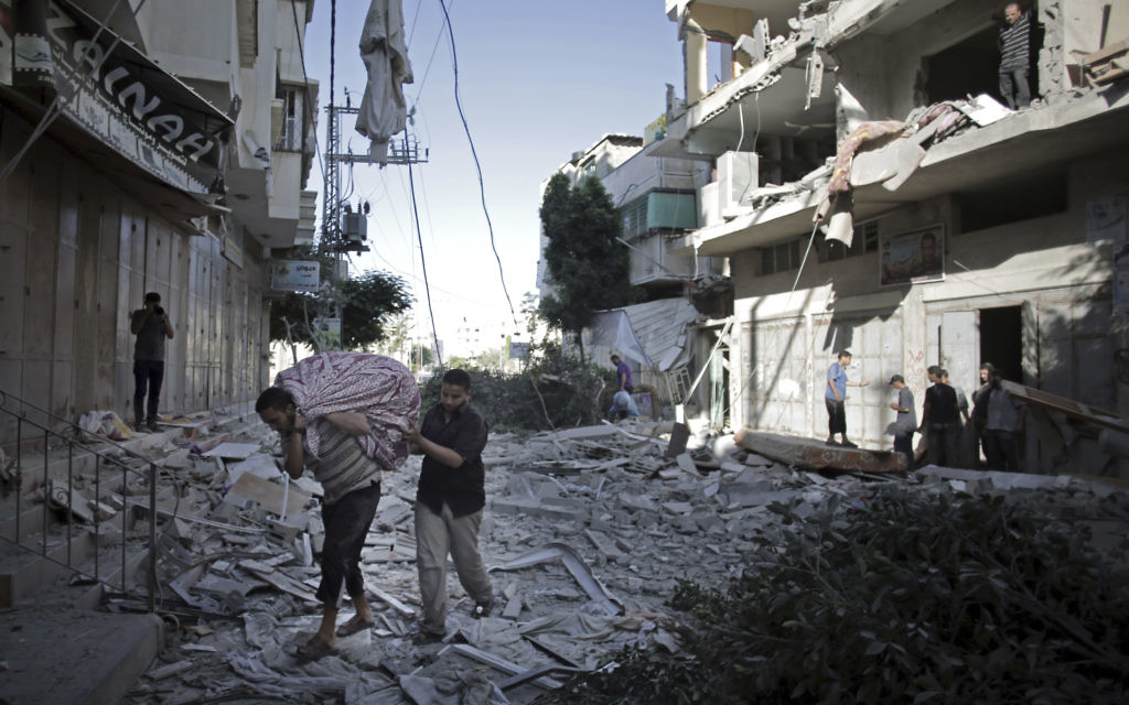 A long-term ceasefire brings an end to seven weeks of fighting between Israel and Hamas, leaving many houses devastated.