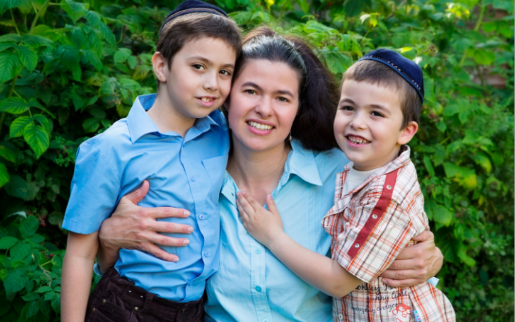 Together again: Rachael Neustadt with two of her three sons