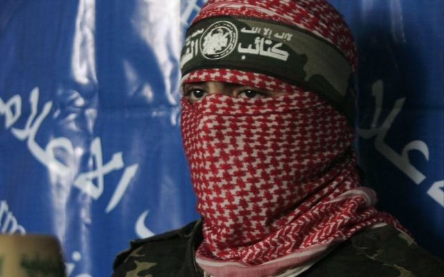 A masked Hamas spokesman
