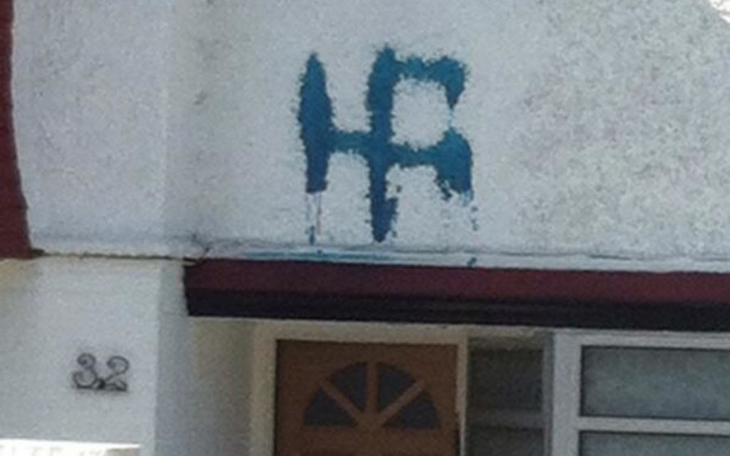 A swastika daubed on a house in Hendon recently.
