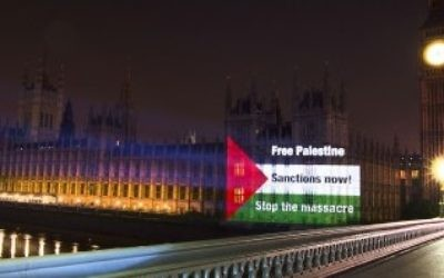 The Palestine Solidarity Campaign project an image onto the Houses of Parliament.