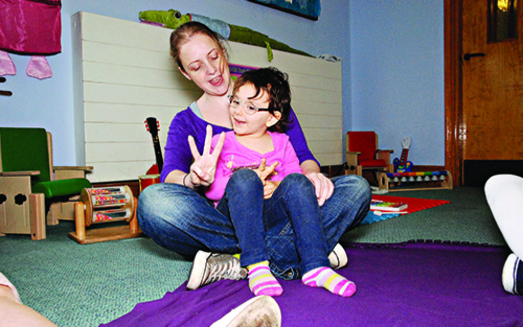 Three-year-old Nisha joins in a one-to-one session at Teenie Tiny