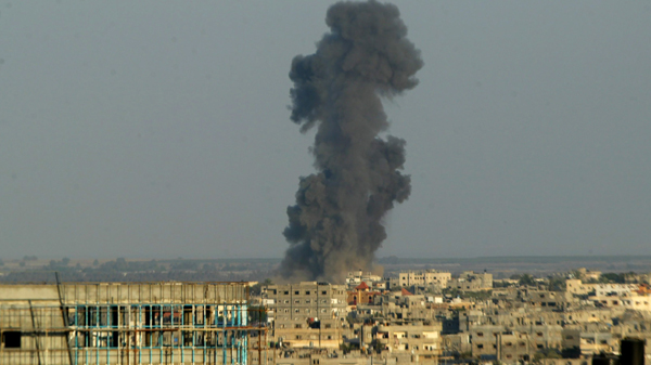 Smoke is seen after what witnesses said was an Israeli air strike in the southern Gaza strip in 2014