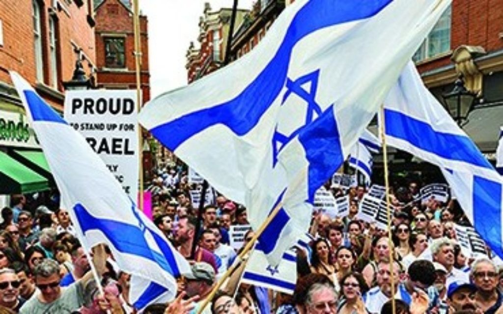 Hundreds of British Jews show their pride in Judaism and Israel at a rally in Kensington earlier this year.