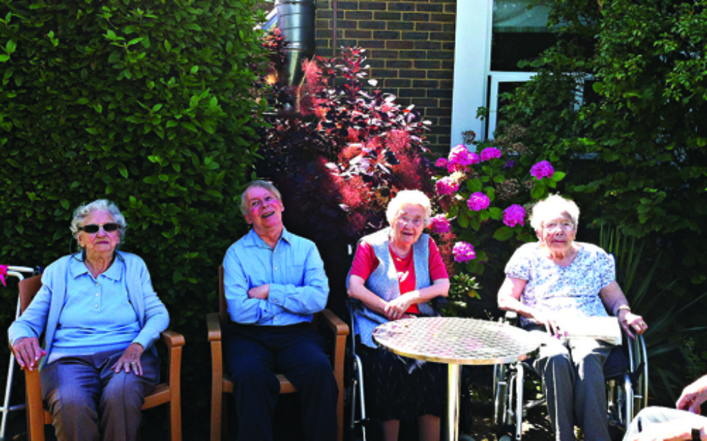 Residents enjoying the afternoon sunshine after lunch and that essential glass of sherry.