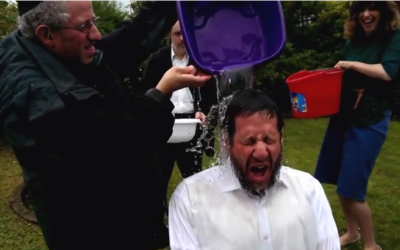 Rabbi Schochet completing the ice bucket challenge