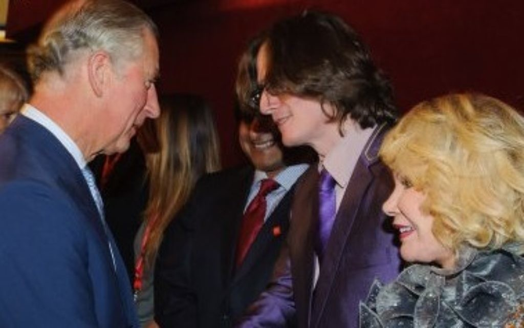 Prince Charles meeting Joan Rivers at the 2012 Prince's Trust Comedy Gala in London.