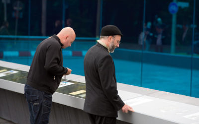 Visitors view the monument for the victims of the Nazi Euthanasia Program (Action T4) in Berlin.