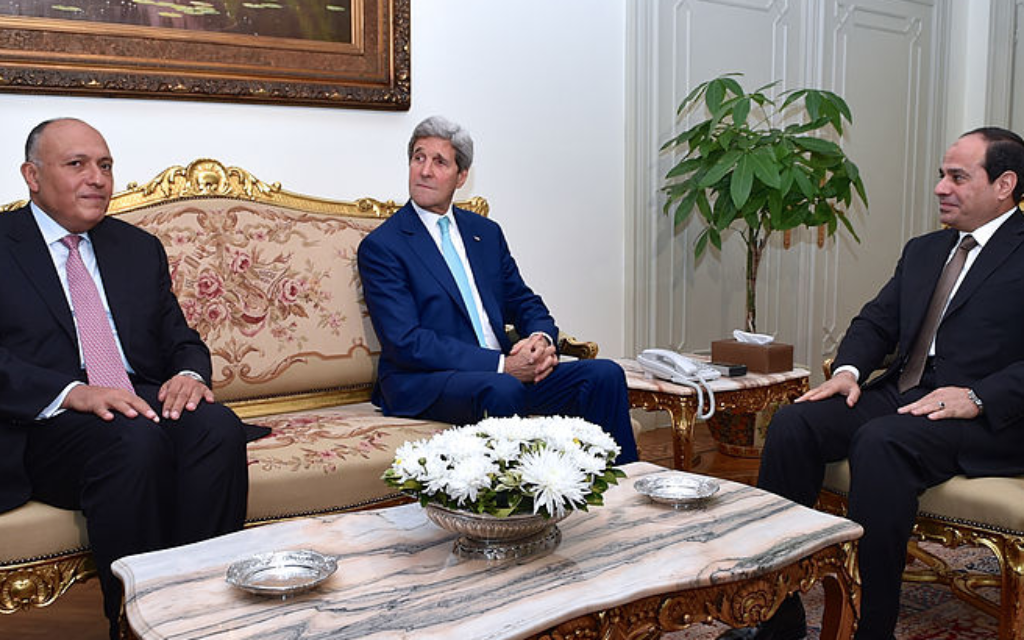 Egyptian President Abdel Fattah al-Sisi meets with U.S. Secretary of State John Kerry and Egyptian Foreign Minister Sameh Shoukry at the Presidential Palace in Cairo on July 22 to discuss a ceasefire in Gaza.