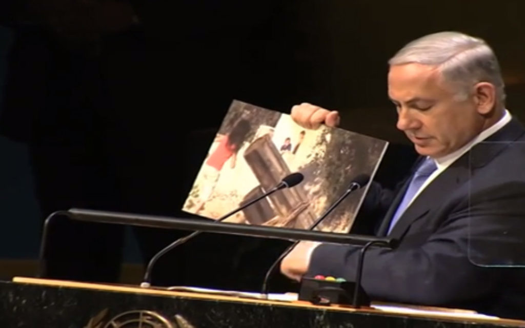 Netanyahu holding up pictorial assistance