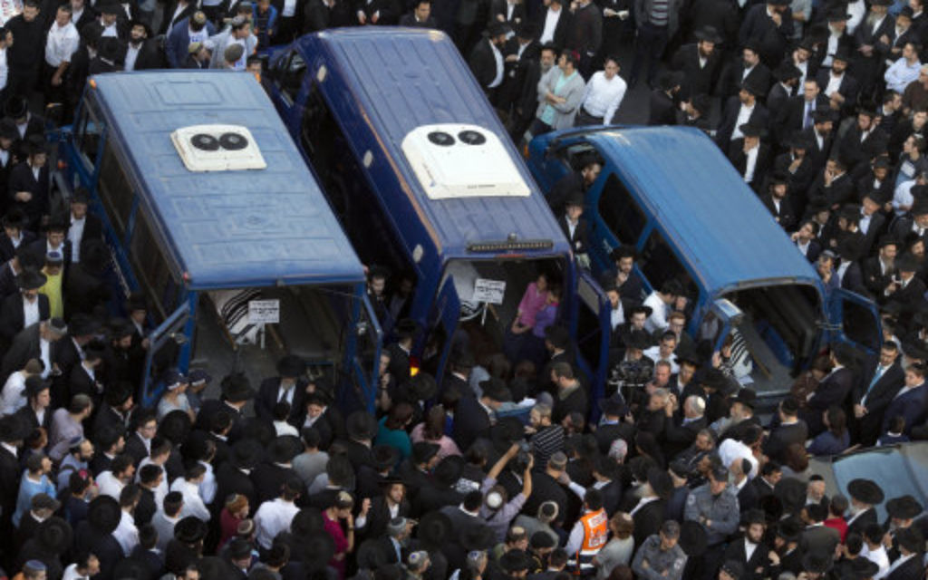 Mourners attend the funerals of Aryeh Kupinsky, Cary William Levine, and Avraham Goldberg, three of the five people killed in a synagogue in Jerusalem.