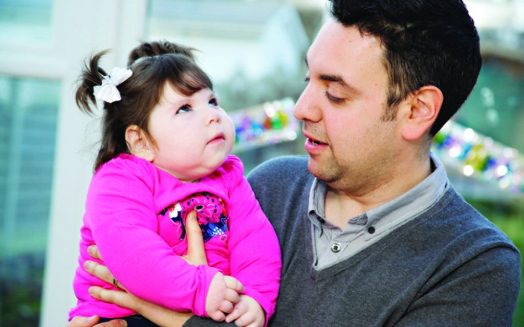 Lee Bladon with his daughter Evie. Lee supports Camp Simcha, which he says has 'thrown his family a lifeline'