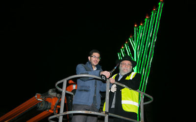News Editor Justin Cohen on the Cherry Picker, to light the Chanukiah!