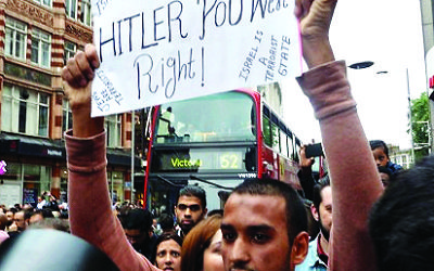 Hussain Yousef holding an anti-Semitic sign 'Hitler was right' in London, 2014