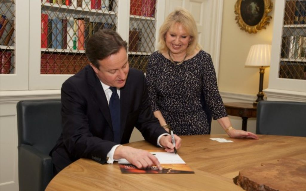 The Prime Minister, David Cameron, signing during his Chanukah reception in 10 Downing Street