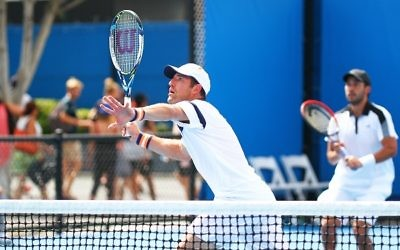 Jonathan Erlich is through to the second round of the men's doubles competition.