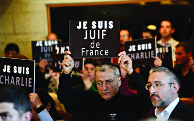 "Members of the French Jewish community hold signs reading ""I am Charlie"" and ""I am a Jew from France"" at a rally in Jerusalem, Israel in January 2015"