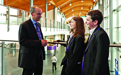 JCoSS headteacher with students at the Barnet school