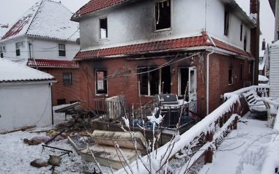The scene of the Brooklyn house fire that claimed seven lives.