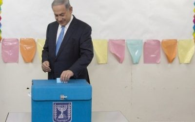Israeli Prime Minister Benjamin Netanyahu casts his vote during Israel's parliamentary elections in Jerusalem, 2015.