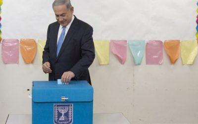 Israeli Prime Minister Benjamin Netanyahu casts his vote during Israel's parliamentary elections in Jerusalem, 2015.
